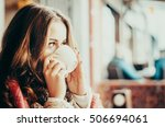 beautiful girl with a cup of...   Shutterstock . vector #506694061