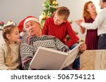 watching family photos together.... | Shutterstock . vector #506754121