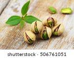 Few Open Pistachio Nuts In...