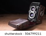 old camera photo on a wooden... | Shutterstock . vector #506799211