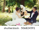 smiling couple fiddling stuffed ... | Shutterstock . vector #506824591