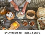 Top view of ingredients for homemade baking. Making dough by female hands breaking the egg in preparation of the dough. Christmas cookies.  - stock photo