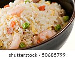 Closeup Bowl of Shrimp Stir Fry Rice, Traditional Chinese Food, Dark Bowl - stock photo