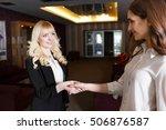 two businesswomen shaking hands ... | Shutterstock . vector #506876587