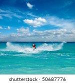 Man Riding Jet Ski In Caribbea...