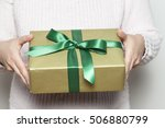 Small photo of Woman holding a present