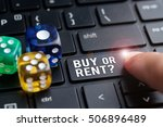 Small photo of Finger on laptop keyboard written Buy or Rent? Decision making concept