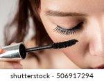 Woman Applying Mascara On...