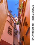 Small photo of GUANAJUATO, MEXICO - DECEMBER 31, 2014 Kiss Alley Alleyway People Colored Houses Guanajuato Mexico. Houses so close couple can exchange a kiss between balconies