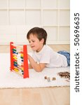 Little boy counting his savings - a pile of coins - financial education concept - stock photo