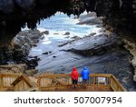 Tourists Visit The Cave Of...