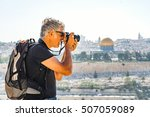 man photographing tourists in... | Shutterstock . vector #507059089