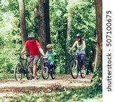 Cheerful Family Biking Togethe...
