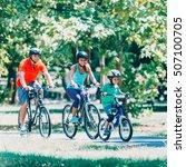 cheerful family biking in park   Shutterstock . vector #507100705