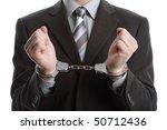 Corporate crime concept, businessman wearing handcuffs - stock photo