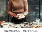 baker holding dish with... | Shutterstock . vector #507127861