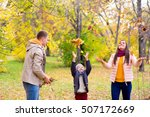 Family Playing With Leaves...