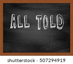 Small photo of ALL TOLD hand writing chalk text on black chalkboard
