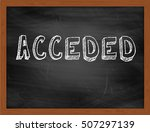 Small photo of ACCEDED hand writing chalk text on black chalkboard