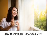 asian girl holding white cup of ... | Shutterstock . vector #507316399