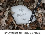 Stock photo pet memorial stone surrounded by fall leaves 507367831