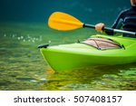 Caucasian Kayaker on the River Telephoto Closeup. Kayak Trip. - stock photo