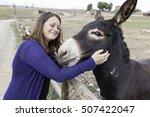 Woman playing naturally donkey...