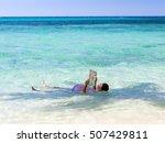 fat man in swimsuit lying in... | Shutterstock . vector #507429811