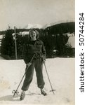 Vintage photo of young skier (1951) - stock photo