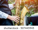 Hands Of Groom Play On Saxophone