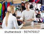 Smiling Cashier Helping...