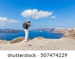 man photographs the sea and the ... | Shutterstock . vector #507474229