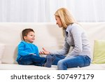 mother and son sitting on sofa... | Shutterstock . vector #507497179