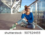 young girl in jeans sitting on... | Shutterstock . vector #507524455