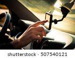man  adjusting  gps in car... | Shutterstock . vector #507540121