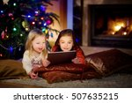 two cute little sisters using a ... | Shutterstock . vector #507635215