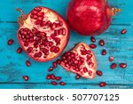 ripe pomegranate and grains on... | Shutterstock . vector #507707125