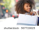 Cheerful Girl Doing Shopping...