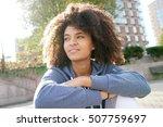 cheerful ethnic girl relaxing... | Shutterstock . vector #507759697