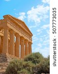 Small photo of The facade of Concordia Temple with huge Doric colonnade and preserved friezes, Agrigento, Sicily, Italy.