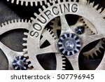 Stock photo macro photo of tooth wheel mechanism with sourcing concept letters 507796945