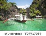 filipino boat in green lagoon ... | Shutterstock . vector #507917059