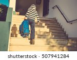 Back View Of Boy Walking On...