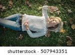 woman listening music on grass... | Shutterstock . vector #507943351