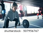 fit healthy woman lifting a... | Shutterstock . vector #507956767