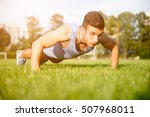 strong athletic man doing... | Shutterstock . vector #507968011