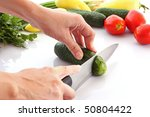 someone cutting a cucumber | Shutterstock . vector #50804422