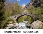Old Stone Arched Bridge Over A...