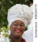 Small photo of Cachoeira, Bahia, Brazil - 29 October 2016 - traditional Bahian black woman with typical clothing in the Oyster Festival in Quilombo Community kaonge