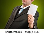 Businessman is holding a blank business card - stock photo